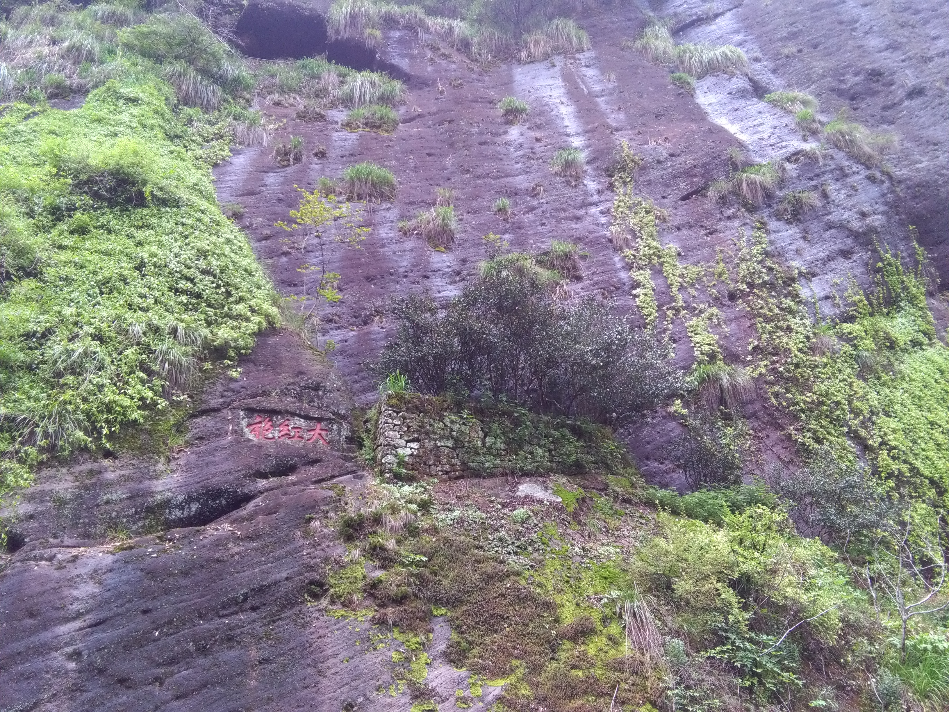 Big Red Robe on steep cliff